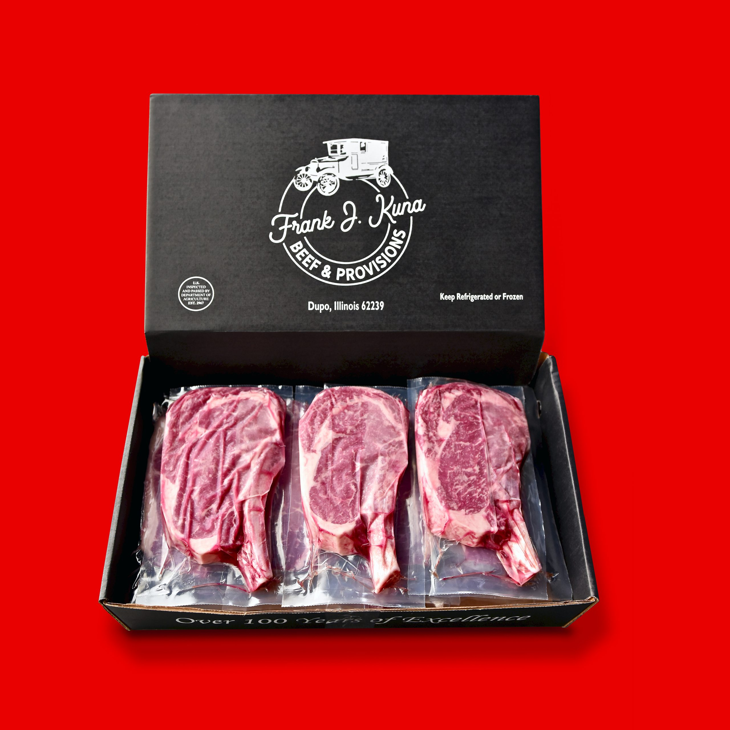 Frank J Kuna packaged steaks over red background